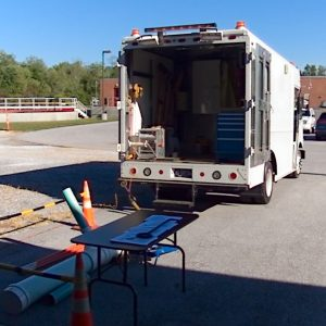 Sewer Department demonstrating the use of the Tv inspection truck during Open House.