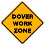 "Yellow, diamond-shaped traffic sign with black text, ""Dover Work Zone"""