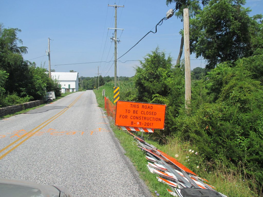 Bright orange road sign stating that Nursery Rd will be closed from August 7th and August 21st, 2017. This closure will disrupt travel on Nursery Road between Butter Road and George Street.