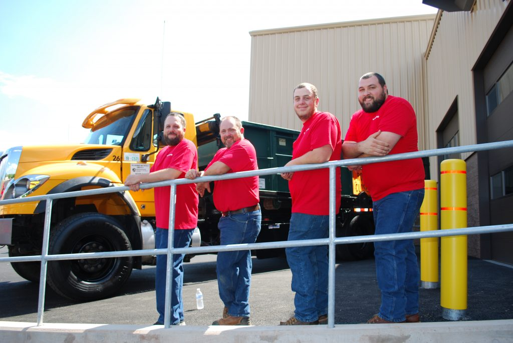 Dover Township Water Department group picture all wearing red shirts. From left to right, Mike Ladd, Matt McWilliams, Stanley Jett and Matthew Helwig.