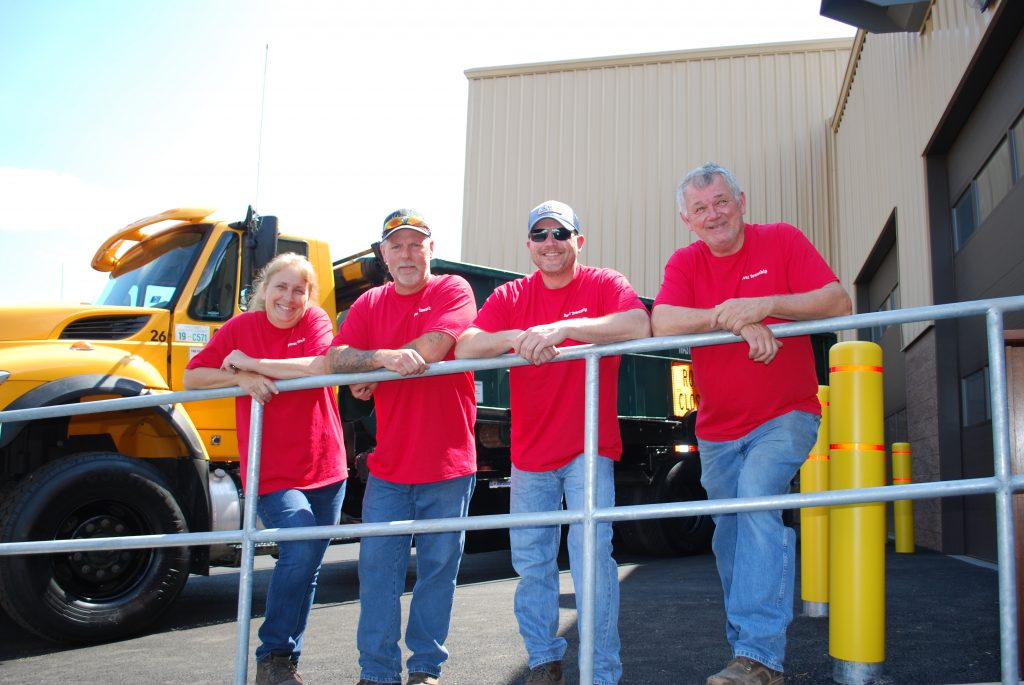 Dover Township Facilities & Parks Department Group Picture wearing red shirts. From left to right, Tracy Kreiger, Bill Barshinger, Judd Wolfe and Wayne Latchaw.