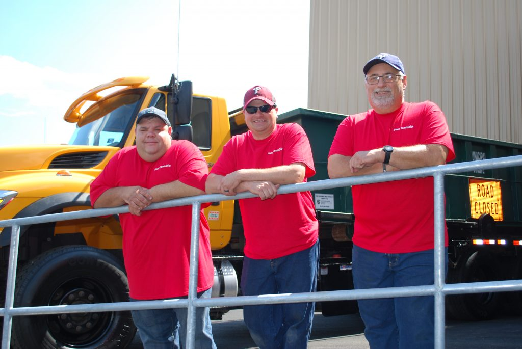 Dover Township Sewer Department group picture wearing red shirts. From left to right, Shawn Appler, Chris Hamme and Glenwood Leas.