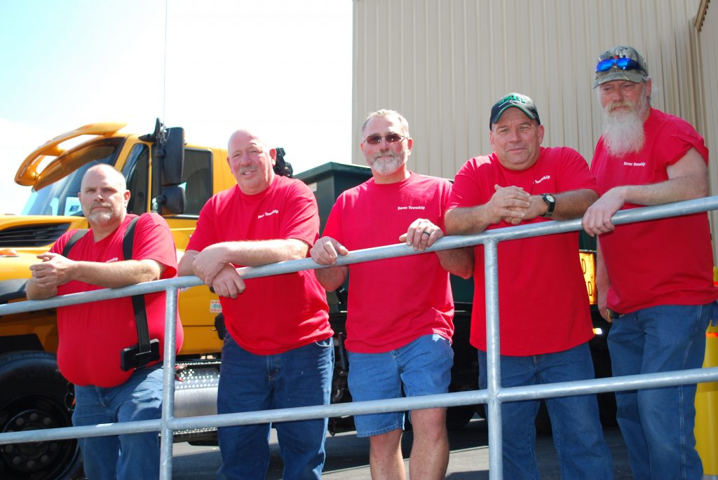 Dover Township Roads Department group picture wearing red shirts. From left to right, Martin Smith, Duane Hull, Gerald Lighty, Fran Eyler and Mike Feight.