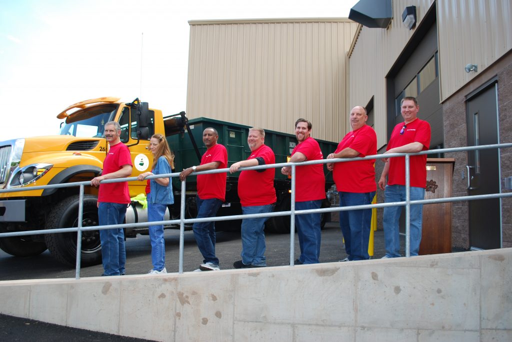 Dover Township WWTP Group Picture wearing red shirts.