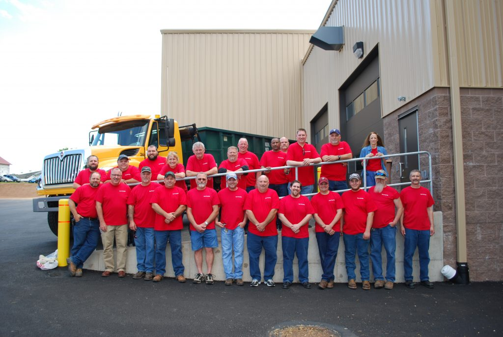 Dover Township Public Works Group picture everyone wearing matching red shirts.