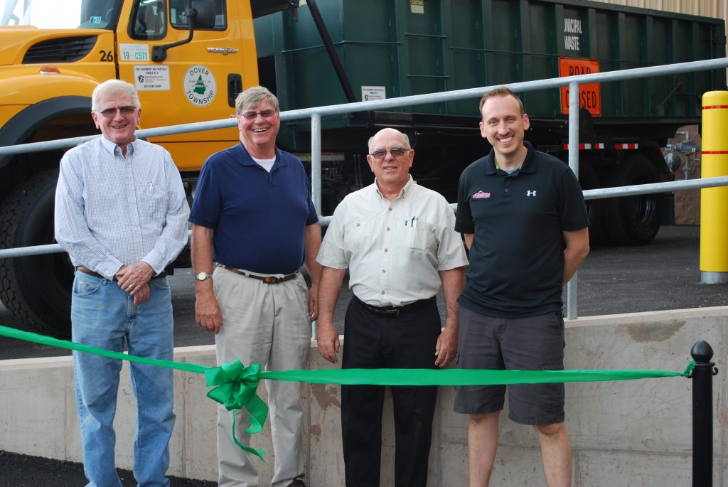 Picture of the Board of Supervisors standing behind a green ribbon. From left to right, Steve Parthree, Chuck Richards, Steve Stefanowicz and Mike Cashman. Missing is Rob Stone.