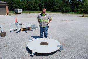 Photo 4 – Aaron standing next to mixer shaft parts to provide you an idea as to how big the equipment is.