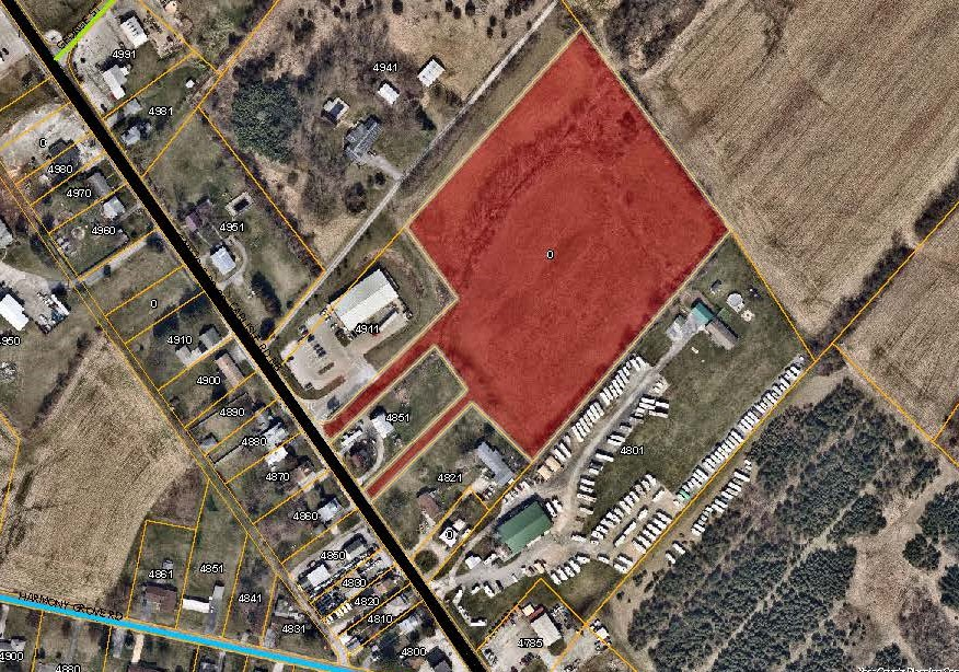 aerial map with the land behind 4911 Carlisle Rd Priority Parcel colored in red. Click to the map picture to be redirected to the Dover Township interactive zoning map.