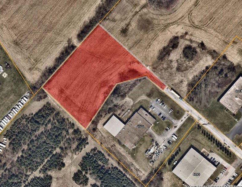 aerial map with the Raycom Rd Priority Parcel colored in red. Click to the map picture to be redirected to the Dover Township interactive zoning map.
