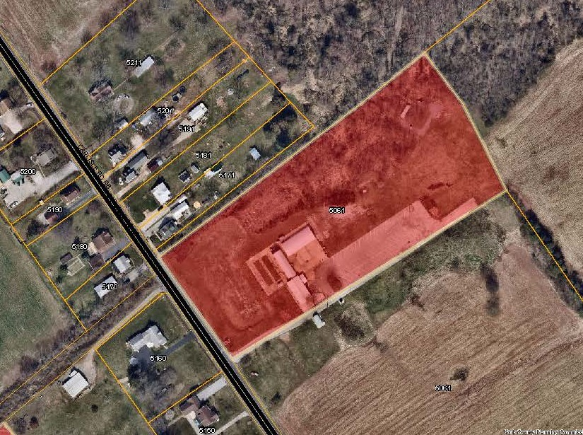 aerial map with 5061 Carlisle Rd Priority Parcel colored in red. Click to the map picture to be redirected to the Dover Township interactive zoning map.