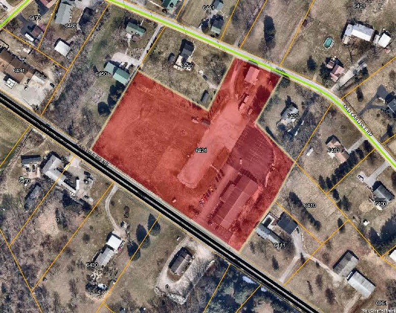 aerial map with 6421 Carlisle Rd Priority Parcel colored in red. Click to the map picture to be redirected to the Dover Township interactive zoning map.