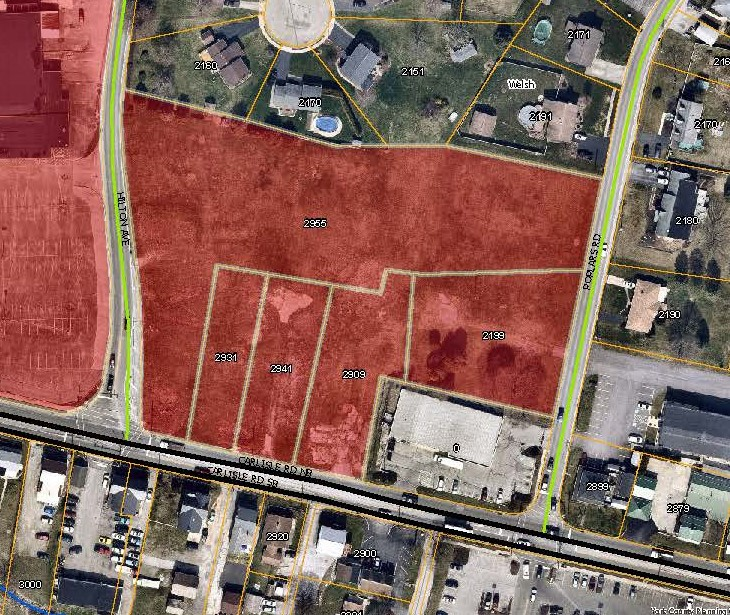 aerial map with the Newberry Plaza Priority Parcels colored in red. Click to the map picture to be redirected to the Dover Township interactive zoning map.