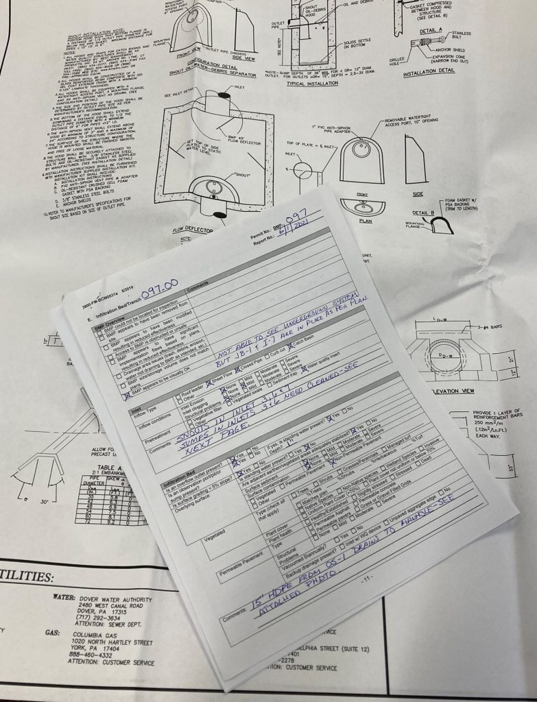 Photo 3 shows a partially completed DEP inspection form and set of construction plans.